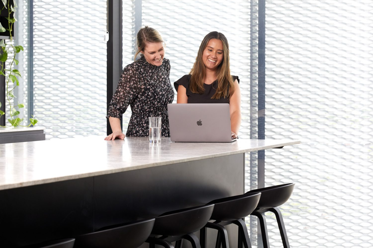 two mortgage brokers looking at a laptop boost borrowing power